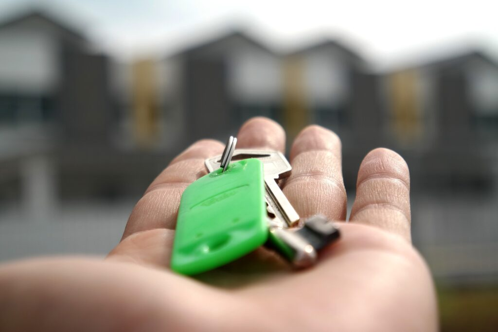 Selective focus of hand holding house keys