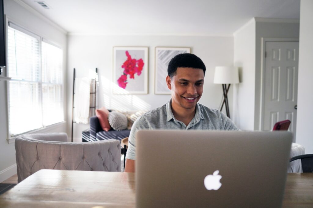 Man entering his home listing into MLS