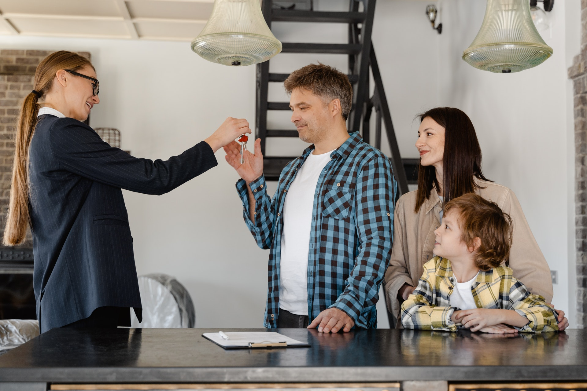 Real estate agent giving the house keys to the new owners