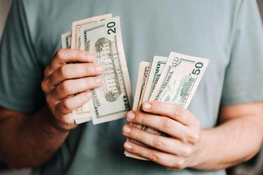Man counting dollar bills