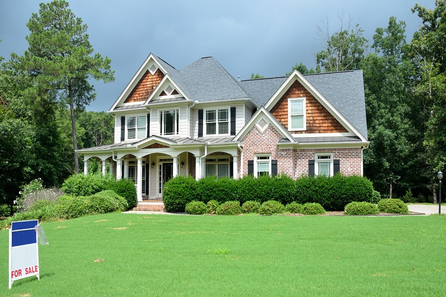 A house for sale with a spacious lawn
