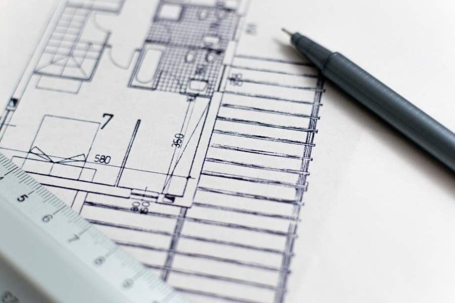 A black pen on top of a house floor plan