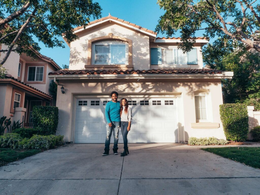 A couple standing in front of their Arizona home