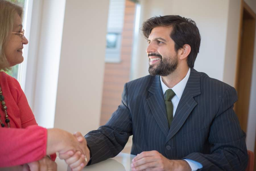 A client negotiating commission fees with a real estate agent