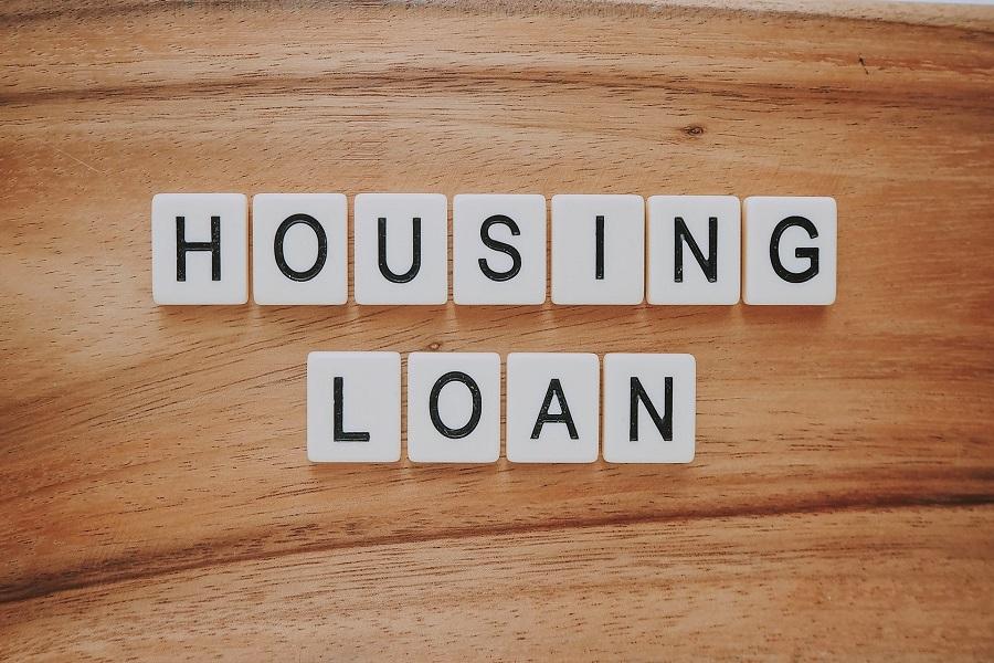 Letter block arranged to spell housing loan